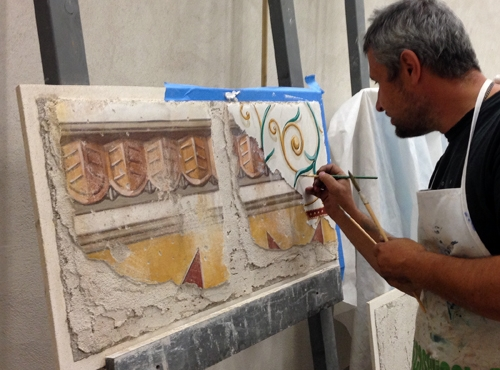 Finishing second layer of intonaco (with Roman plaster) for multi-layer didactic fresco panel, by ilia Fresco
